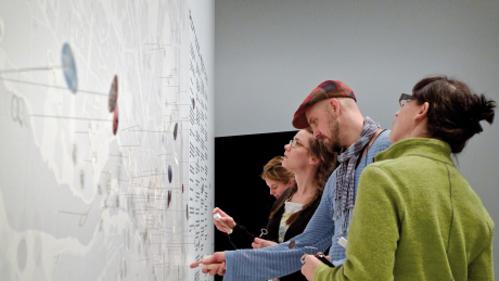 The visitors of the exhibition mark their places on the map